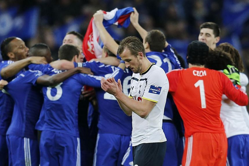Tottenham's Harry Kane looks dejected after defeat as Chelsea players celebrate after the Chelsea v Tottenham Hotspur Capital One Cup Final game at the Wembley Stadium on March 1, 2015. -- PHOTO: REUTERS