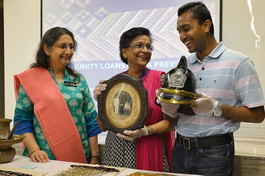 (From left) Indian Heritage Centre director Gauri Krishnan with contributors Salma Moiz and Subhas Gopal and the artifacts they are lending the Indian Heritage Centre.-- ST PHOTO:ALPHONSUS CHERN