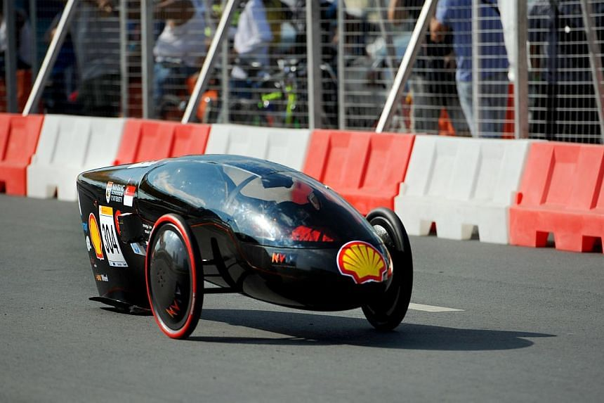 The NTU Venture 9 in action at the Shell Eco-Marathon Asia. The solar-powered car clinchedboth the competition's Technical Innovation and Safety awards, for itscontoured solar panels and a tilting mechanism that allows the vehicle to take