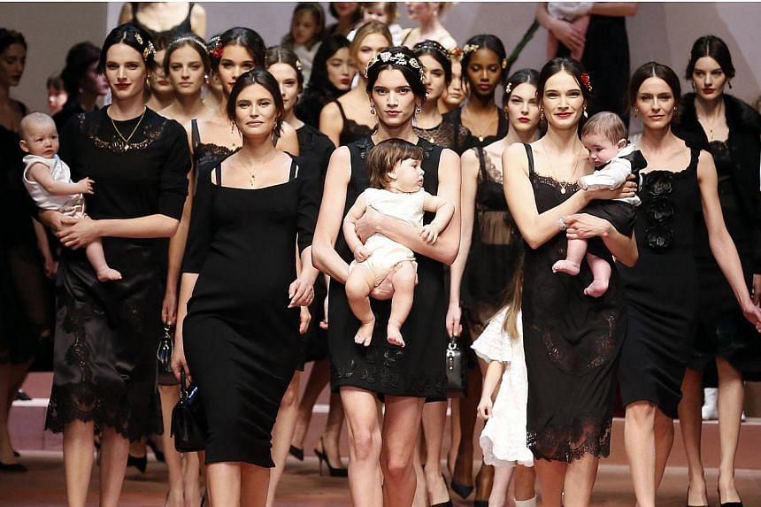Model Bianca Balti (second left) joining other models as they present creations from the Dolce & Gabbana Autumn/Winter 2015-16 collection during Milan Fashion Week on March 1, 2015. -- PHOTO: REUTERS