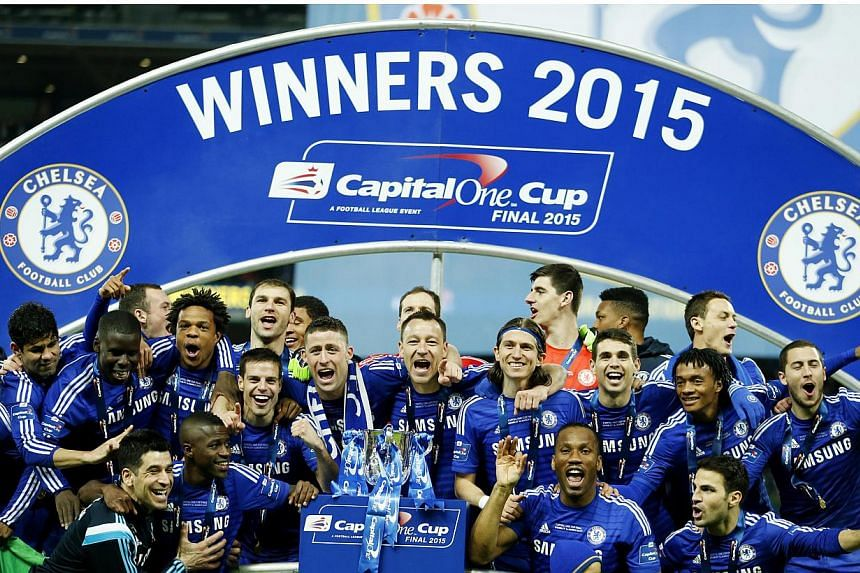 """Chelsea players celebrate after winning the Capital One Cup.Chelsea manager Jose Mourinho said he felt """"like a kid"""" after claiming the first trophy of his second Stamford Bridge tenure with a League Cup final victory over Tottenham Hotspur. --"""