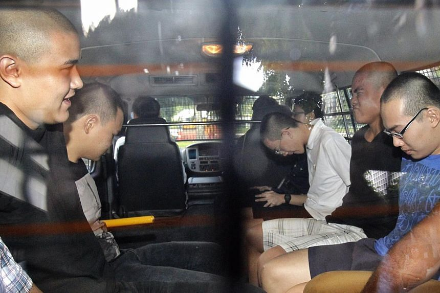 (From left) David William Graaskov, Goh Rong Liang, Chay Nam Shen, Boaz Koh Wen Jie, and Reagan Tan Chang Zhi arriving at the States Court on 10 May 2014. Chay and Tan were each given 24 months' probation on Monday. -- PHOTO: ST FILE