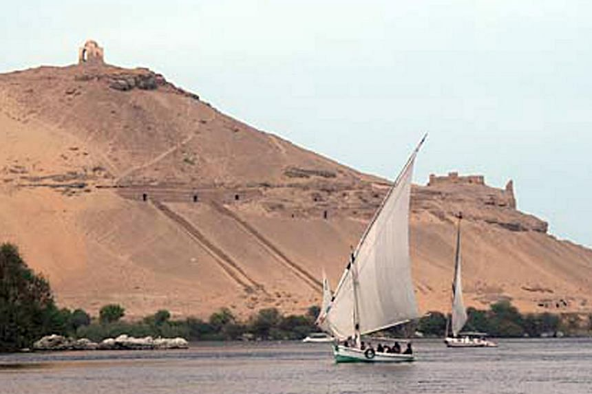 A traditional Eqyptian traditional yacht called a Felucca cruises along the Nile River in Aswan, Egypt. -- PHOTO: Reduan Yahya
