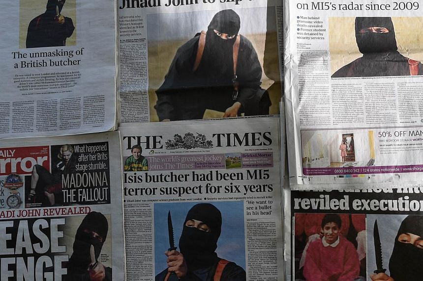 "British daily newspapers photographed in London on Friday show the front-page headlines and stories regarding the identification of the masked Islamic State group militant dubbed ""Jihadi John"", who has been named as Kuwaiti-born computing graduate Mo"