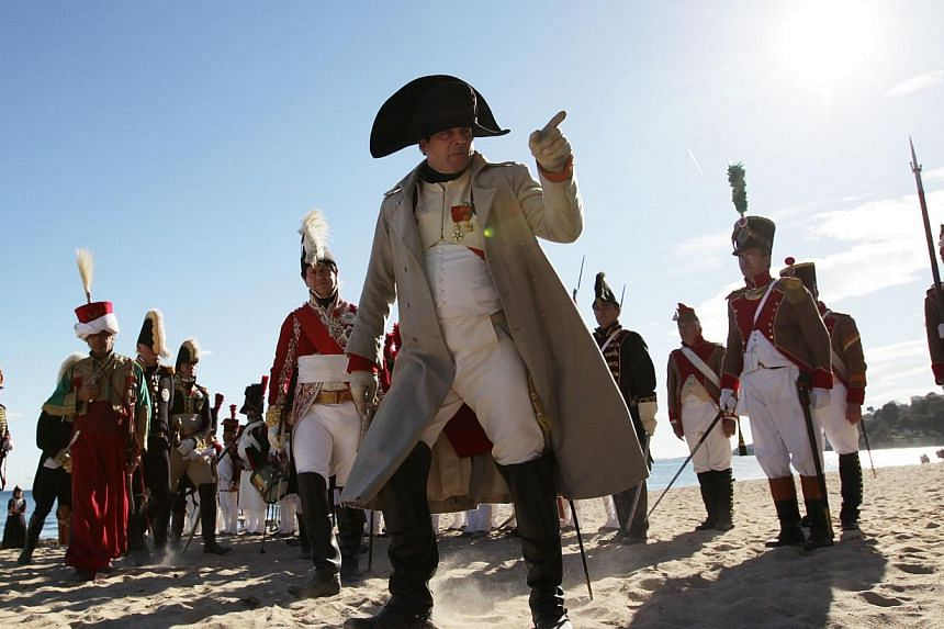 French actor Frank Samson, dressed as French Emperor Napoleon Ier performs, during the reenactment of Napoleon's landing, on Sunday, in Vallauris Golfe-Juan, southeastern France. This commemoration celebrates the bicentenary of the Emperor's landing