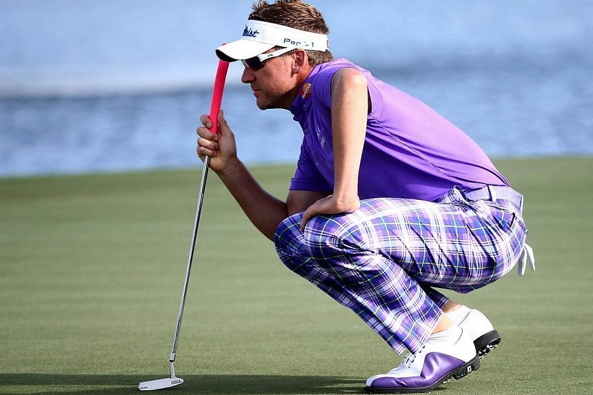 Ian Poulter of England lines up a putt on the 18th green during the continuation of the third round of The Honda Classic at PGA National Resort & Spa - Champion Course on Sunday in Palm Beach Gardens, Florida. -- PHOTO: AFP