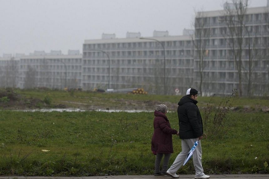 Picture taken on November 14, 2014 in Aarhus shows people walking in one of Denmark's poorest neighbourhoods. Danish authorities forced a 15-year-old boy into a juvenile home in an unusual move to thwart Islamist radicalisation, local media reported