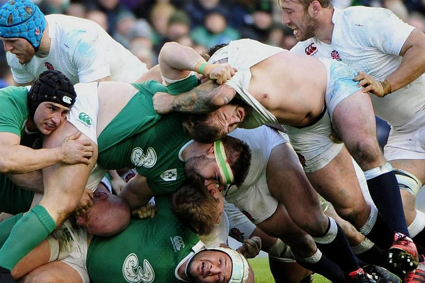 Ireland's Rory Best caught at the bottom of a ruck during the Six Nations Rugby match between Ireland and England in The Aviva Stadium in Dublin on Sunday. -- PHOTO: EPA