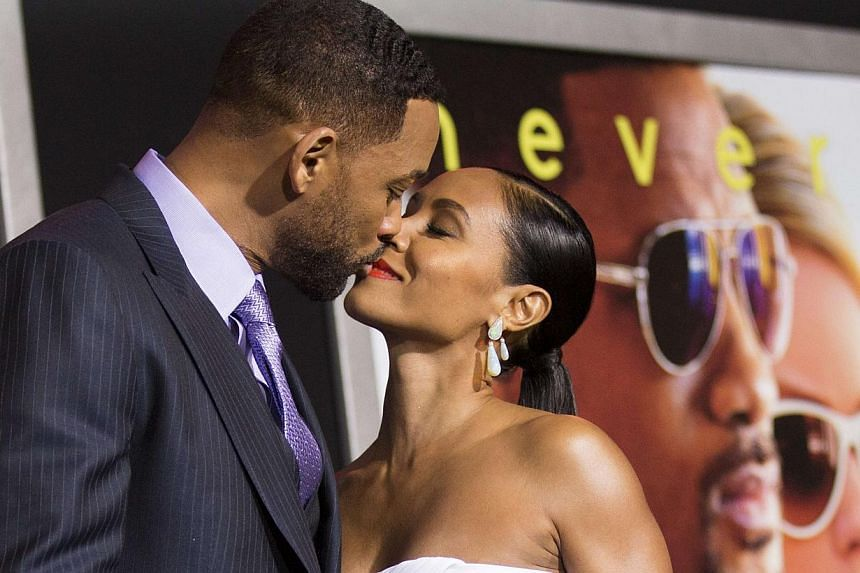 Will Smith and his wife Jada Pinkett Smith kiss at the premiere of Focus last week at the TCL Chinese theatre in Hollywood, California. -- PHOTO: REUTERS