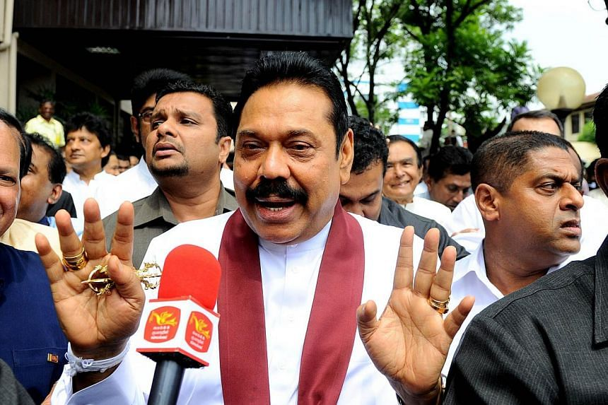 Former Sri Lankan President Mahinda Rajapakse exits the Election Commission office after handing over his nomination papers in Decembe. -- PHOTO: AFP