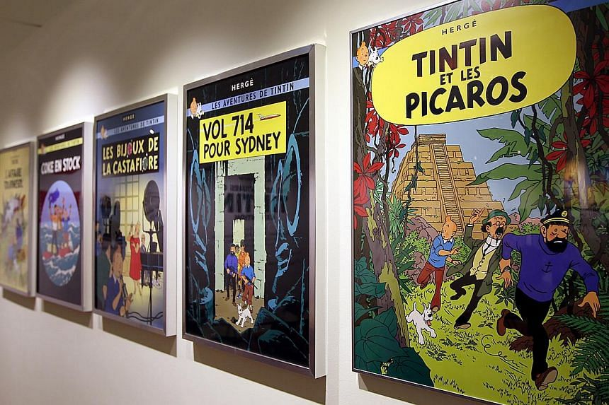Comic posters at Tintin's 100th Anniversay exhibition at the Singapore Philatelic Museum in 2011. -- PHOTO: Johari Rahmat
