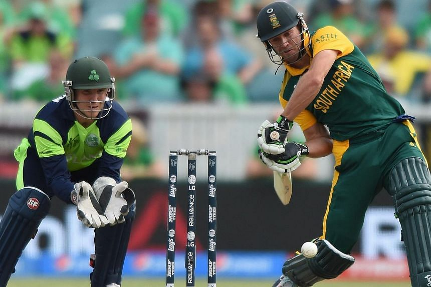 South Africa's batsman AB De Villiers (right) plays a shot during the Ireland and South Africa in the ICC Cricket World Cup match at the Manuka Oval in Canberra, Australia, March 3, 2015. -- PHOTO: EPA