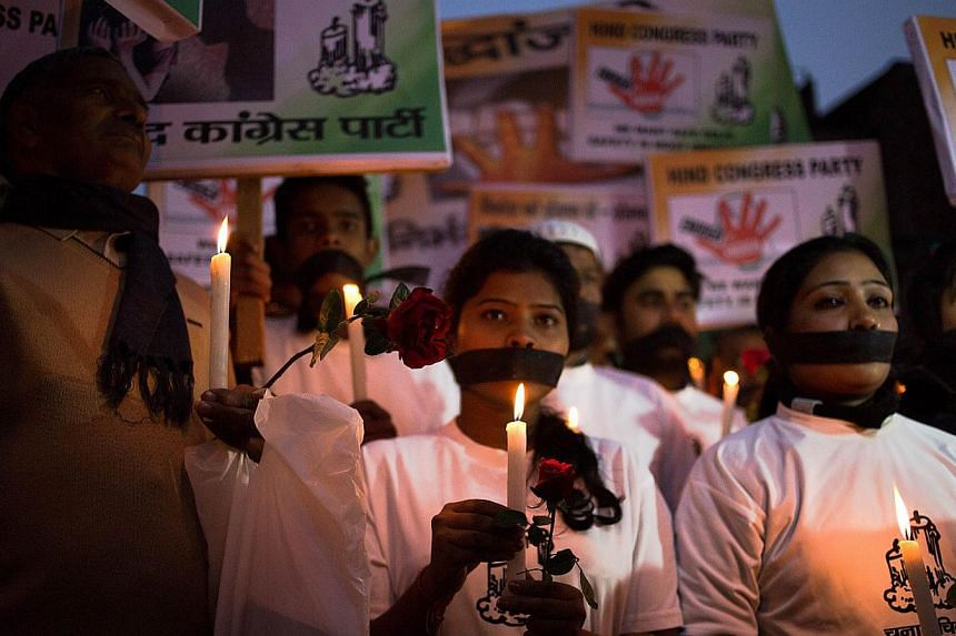 Indian political and civil society activists take part in a vigil to mark the second anniversary of the fatal gang-rape of a student in the Indian capital, at the bus stop in the Munirka area of New Delhi on Dec 16, 2014. One of the men convicte
