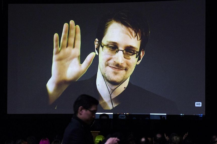 Former US National Security Agency contractor Edward Snowden appears live via video during a student organised world affairs conference at the Upper Canada College private high school in Toronto on Feb 2, 2015. The fugitive whistleblower now wishes t