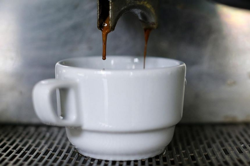 A cup of coffee is served at a coffee shop in Caracas on Feb 26, 2015.People who drink three to five cups of coffee a day may have a lower risk of clogged arteries that can cause serious heart problems, a study said Tuesday. -- PHOTO: REUTERS