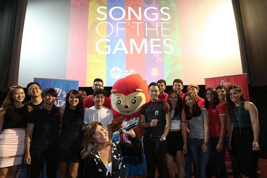 Artists and musicians involved in the SEA Games official album with Team Singapore athletes and Nila the games mascot. -- ST PHOTO: NEO XIAOBIN