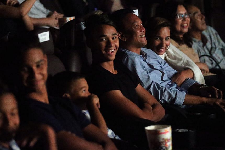 LionsXII head coach Fandi Ahmad, with his family, during the screening of a video inspired by the story of his life. -- ST PHOTO: NEO XIAOBIN