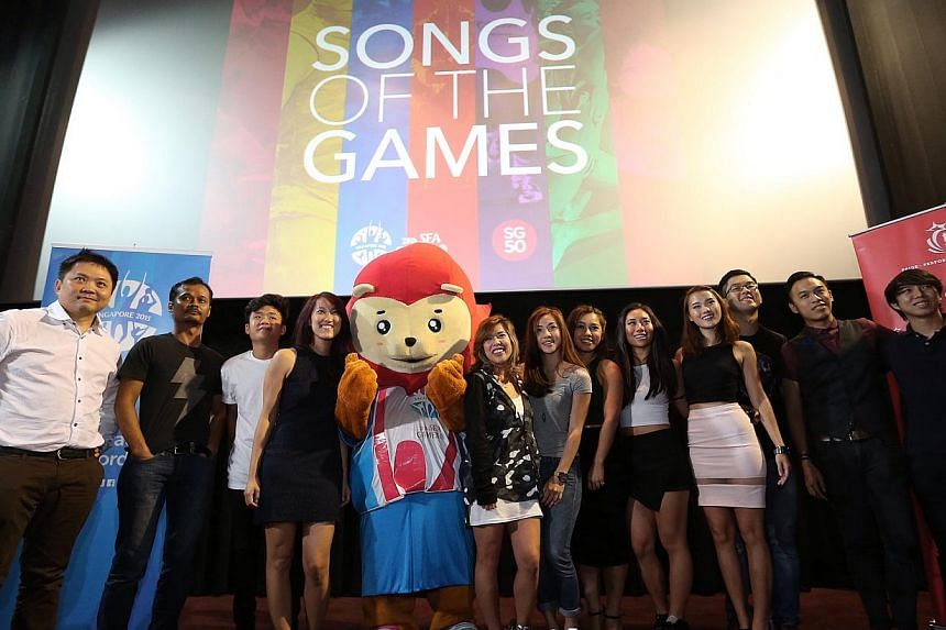 Artists and musicians involved in the SEA Games official album with Nila the games mascot. -- ST PHOTO: NEO XIAOBIN