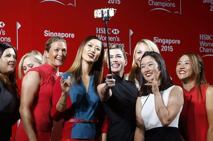 (Left to right) Inbee Park, Jessica Korda (partially blocked), Suzanne Pettersen, Michelle Wie, Paula Creamer, Anna Nordqvist (partially blocked), Chella Choi and Lydia Ko take a group selfie after a catwalk segment of the HSBC Women's Champions pres