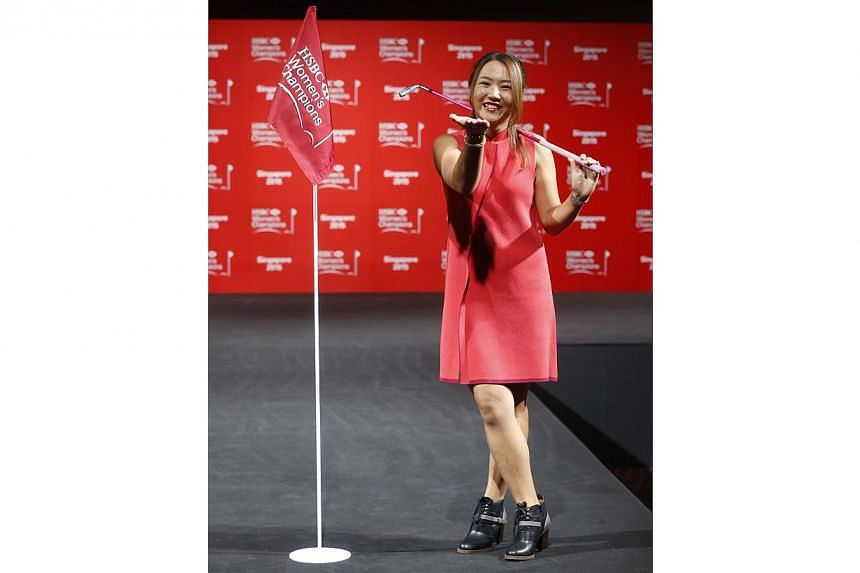 World number one Lydia Ko of New Zealand blows a kiss at the camera during a catwalk segment of the HSBC Women's Champions press conference at Raffles City Convention Centre on March 3, 2015. -- ST PHOTO: KEVIN LIM