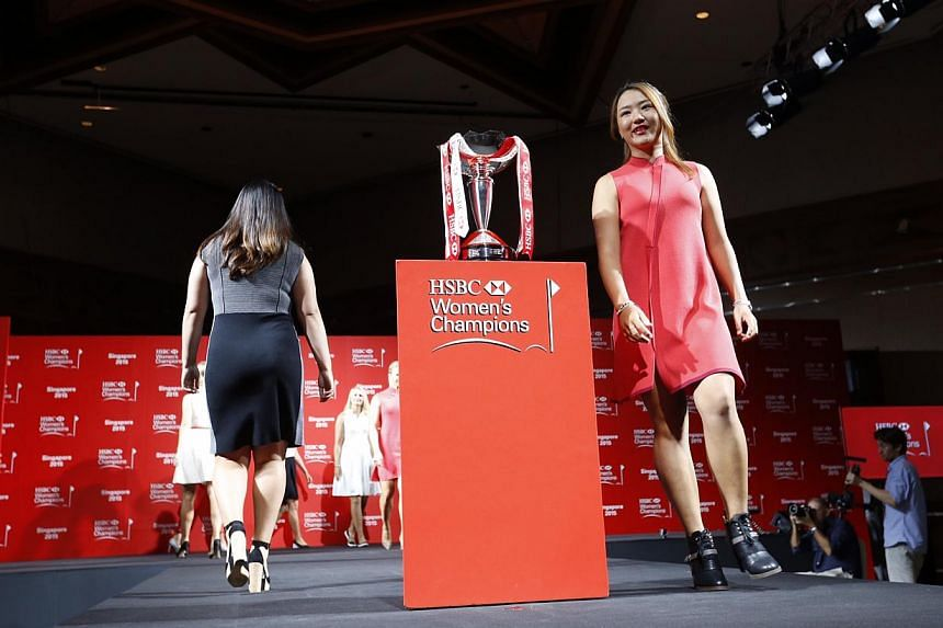 World number one Lydia Ko of New Zealand walks with seven others during a catwalk segment of the HSBC Women's Champions press conference at Raffles City Convention Centre on March 3, 2015. -- ST PHOTO: KEVIN LIM