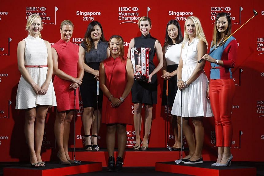(Left to right) Jessica Korda, Suzanne Pettersen, Inbee Park, Lydia Ko, Paula Creamer, Chella Choi, Anna Nordqvist and Michelle Wie during a catwalk segment of the HSBC Women's Champions press conference at Raffles City Convention Centre on March 3,&