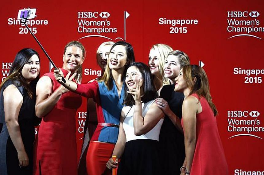 (Left to right) Inbee Park, Suzanne Pettersen, Jessica Korda (partially blocked), Michelle Wie, Chella Choi, Anna Nordqvist, Paula Creamer and Lydia Ko take a group selfie after a catwalk segment of the HSBC Women's Champions press conference at Raff
