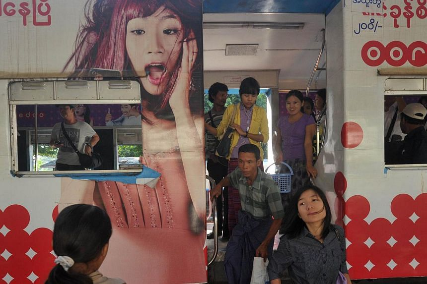 Trains chug around Yangon's circular railway at a stately pace barely faster than a brisk walk, but this creaking relic of colonial times is at the heart of plans for a public transport revolution in the traffic-choked metropolis. -- PHOTO: AFP