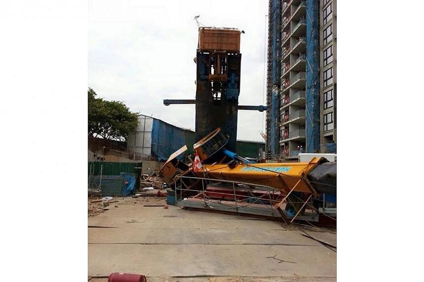 A crane at a construction site of an upcoming executive condominium in Punggol toppled over on Tuesday. -- PHOTO: ST READER