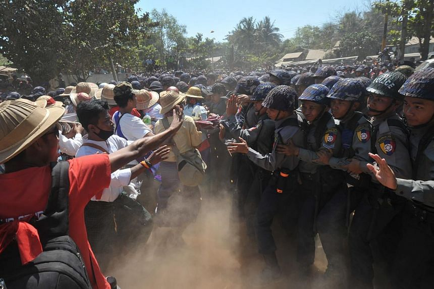 Myanmar riot police (right) confront students (left) during a protest march in Letpadan town, some 130 kilometres north of Myanmar's main city of Yangon on March 3, 2015.Student protesters calling for education reform said Tuesday that riot pol