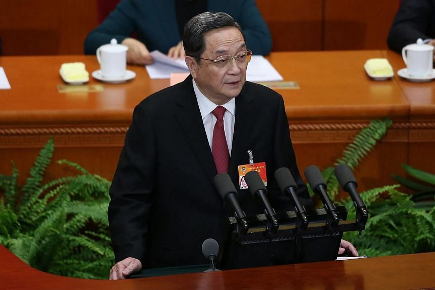 MrYu Zhengsheng, chairman of the National Committee of the Chinese People's Political Consultative Conference (CPPCC), delivers his speech during the opening session of the third plenum of the 12th National CPPCC at the Great Hall of the People