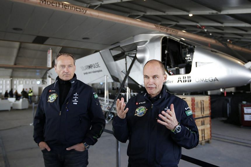 Solar Impulse 2 pilots Bertrand Piccard (right) and Andre Borschberg after the third test flight in Abu Dhabi on March 2, 2015. -- PHOTO: EPA