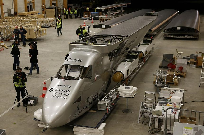 The dismantled Solar Impulse 2 aircraft being loaded into a Cargolux Boeing 747 cargo aircraft at Payerne airport on Jan 5, 2015. -- PHOTO: REUTERS