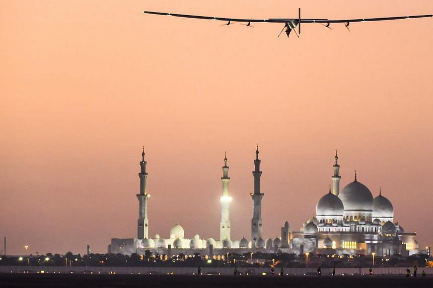 Solar Impulse 2 flying over the Sheikh Zayed Grand Mosque in Abu Dhabi on March 2, 2015. -- PHOTO: EPA