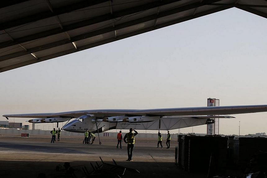 The Solar Impulse 2 landing after the third test flight in Abu Dhabi on March 2, 2015. -- PHOTO: EPA