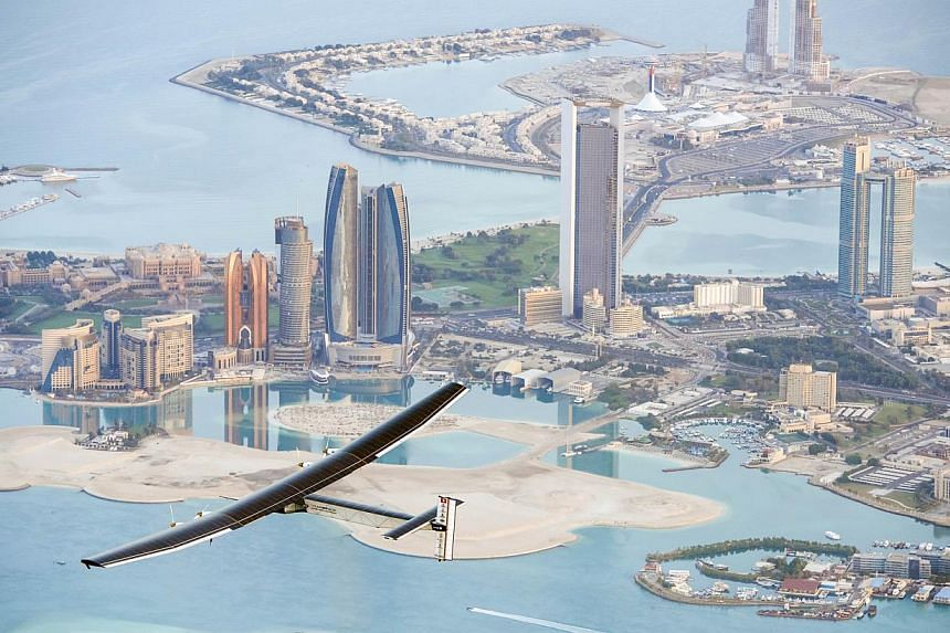A handout picture released by the Solar Impulse project shows the solar-powered plane Solar Impulse 2 flying over the Emirati capital Abu Dhabi on Feb 26, 2015. -- PHOTO: AFP