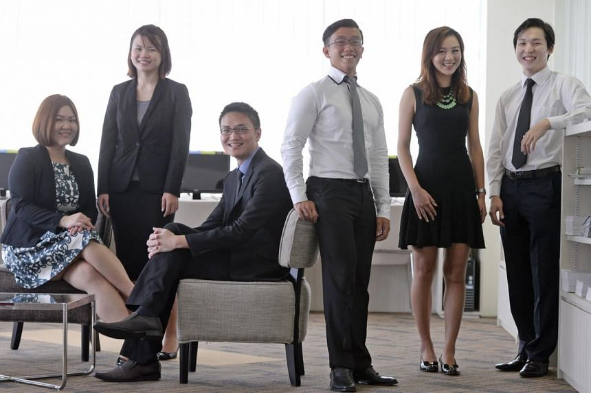 (From left) NUS career advisers Jenny Tan, Xie Jiaying and Desmond Teo with life science student Dean Goh, 23, arts and social sciences student Audrey Li, 23, and computing student Lee Juho, 23, at the Centre for Future-ready Graduates. From this yea