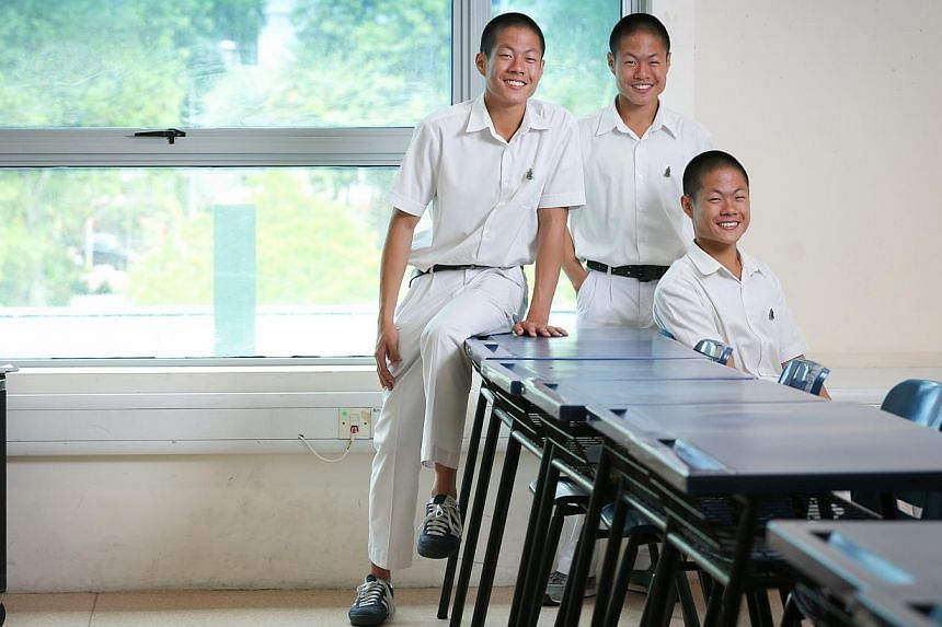 Triplets (from left) Phuah Wei Yuan, Phuah Wei Ke and Phuah Wei Deng scored a total of 13As and two Bs in their A levels.