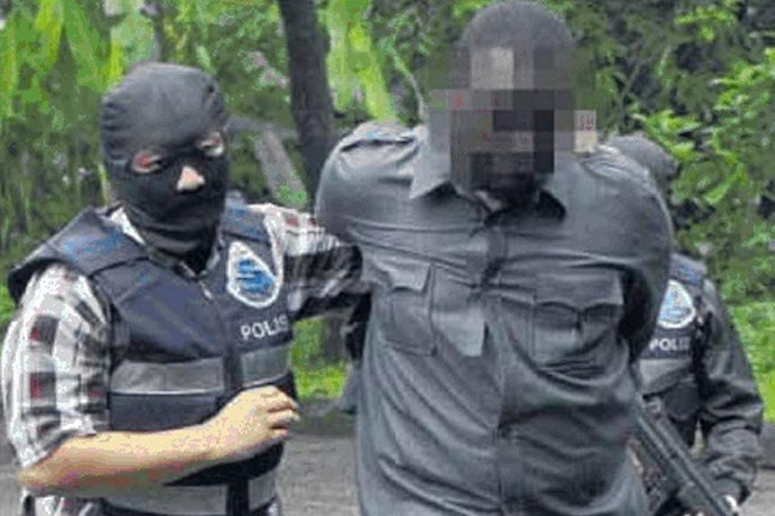 Officers from the Bukit Aman Special Branch Counter Terrorism unit detaining a terror suspect in 2014. Malaysia's new anti-terrorism act that will be tabled in Parliament this month will include provisions that allow for detention without trial and e