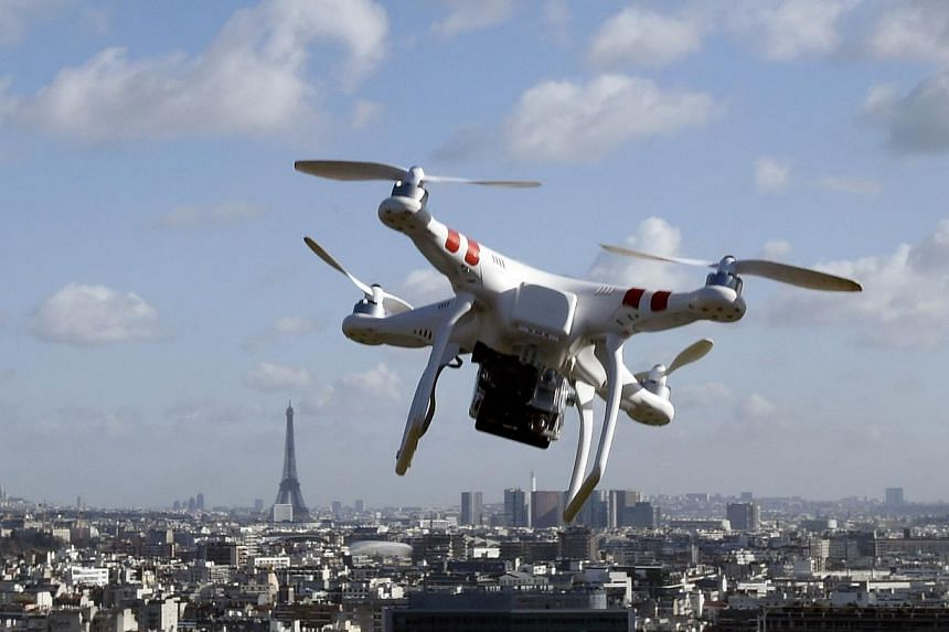 Illustration of a drone flying over Paris on Feb 27, 2015.A French court on Tuesday fined a British journalist €1,000 (S$1,500) for flying a drone over central Paris and confiscated the machine, as authorities scramble to explain a recent ser