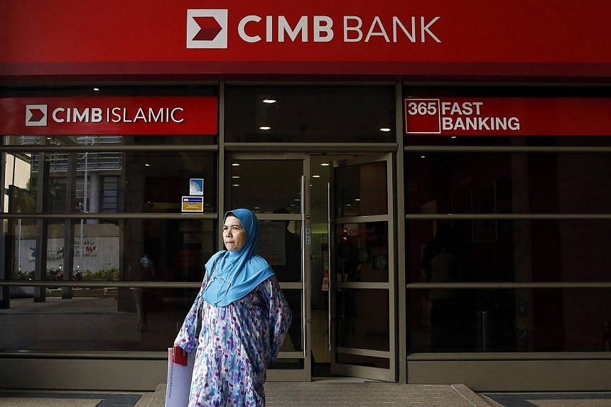 Malaysia's CIMB Group Holdings said it replaced its chief financial officer with his deputy a few days after the bank reported its fourth-quarter profit fell 76 per cent. -- PHOTO: REUTERS