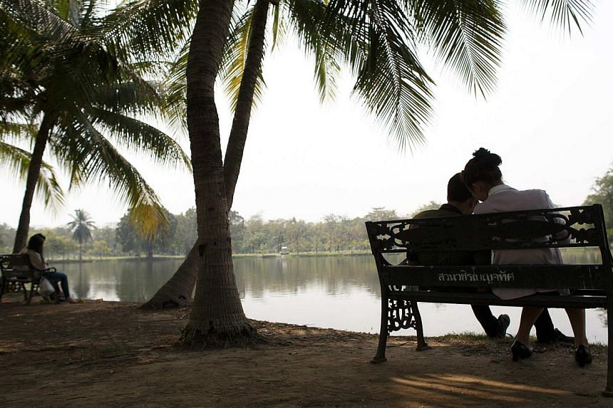 Couples at a park in Bangkok on Feb 11, 2015. -- PHOTO: REUTERS