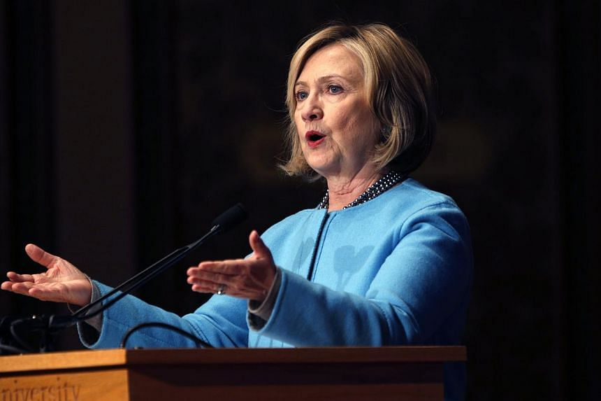 """Former U.S. Secretary of State Hillary Clinton speaks on """"Smart Power: Security Through Inclusive Leadership"""" at Georgetown University in Washington in this December 3, 2014. -- FILE PHOTO: REUTERS"""