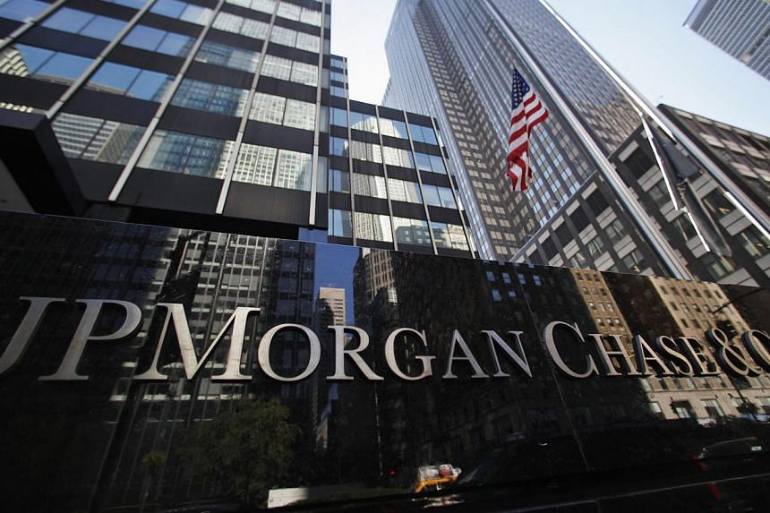 The largest US bank in terms of assets, JPMorgan Chase, plans to save nearly US$5 billion by 2017, and is closing 300 bank branches. -- PHOTO: REUTERS