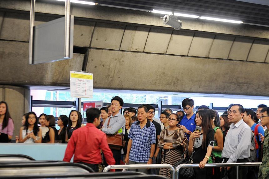 Commuters waiting at the East-West Line's Clementi MRT Station on March 3, 2015. As SMRT issued the statement on Tuesday, another delay occurred on the East-West line from Tanjong Pagar to Jurong East towards Joo Koon. -- ST PHOTO: TIFFANY GOH