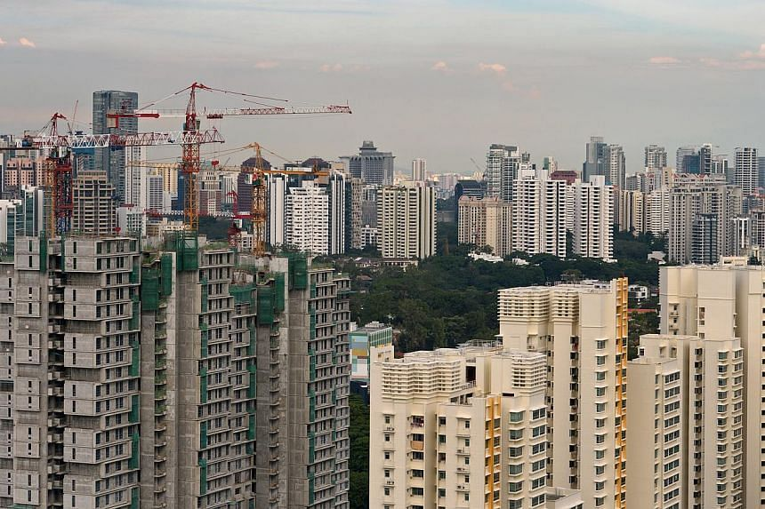 Construction of flats along Margaret Drive and Dawson Road in 2012. Commuters from the new housing estates there will soon enjoy a new bus service that connects them to nearby MRT stations and facilities. -- PHOTO: ST FILE