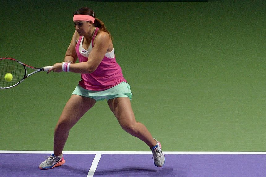 Retired star Marion Bartoli playing in the Legends match at the Singapore Indoor Stadium on Oct 20, 2014.The former Wimbledon champion sparked speculation about a return from retirement on Tuesday - less than two years after bowing out of profe