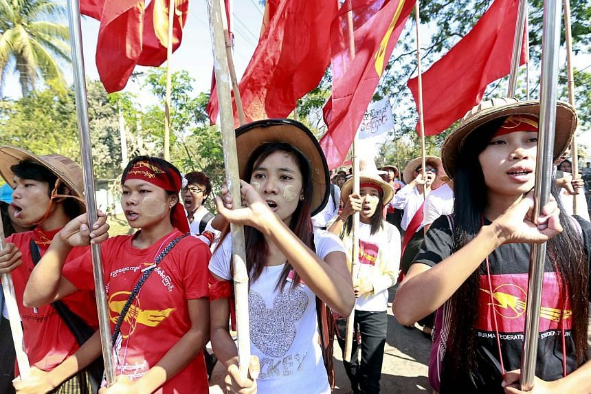 Student shout slogans as they march on the road at Letpadan, Bago division, Myanmar, on March 3, 2015.Student protesters calling for education reform on Tuesday defied an order to disperse in a tense standoff with hundreds of riot police in cen