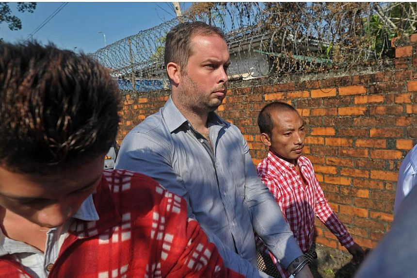 Philip Blackwood (centre) arrives for his hearing at a court in Yangon on Dec 18, 2014. -- PHOTO: AFP