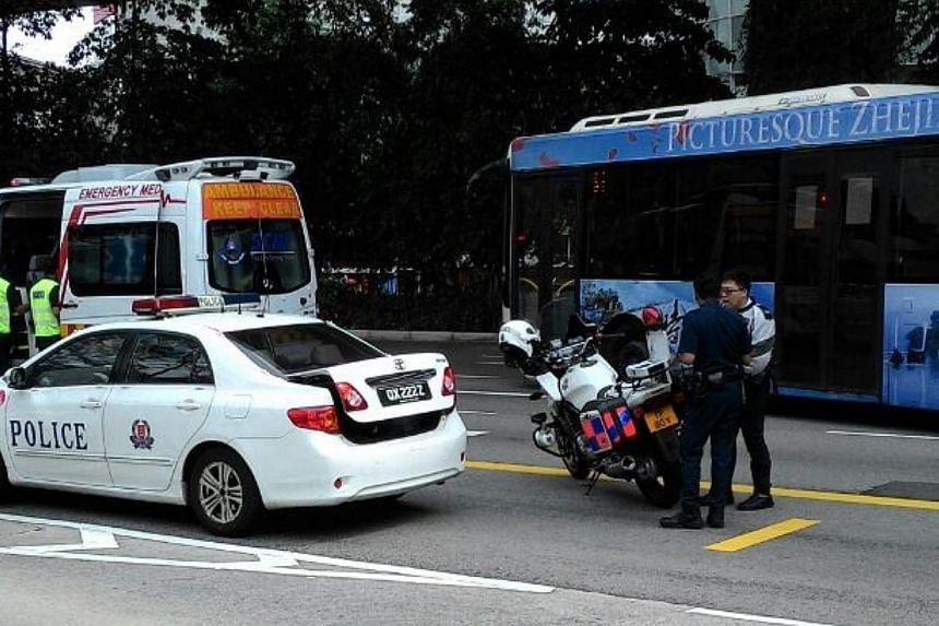 A 25-year-old Vietnamese woman is believed to have fallen from West Coast Highway and landed on Telok Blangah Road on Tuesday afternoon. -- PHOTO: COURTESY OF A COMMUTER AT THE SCENE